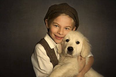 Boy in hat holding dog