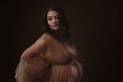 Expectant mother in gown with frills